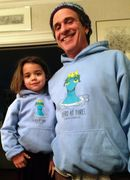 Father and daughter dressed in Heroic Hoodies.