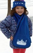 A young girl shows off her constellations scarf/ski band set.