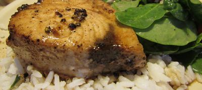 Swordfish filet sauteed in butter and Garlic Lemon Pepper Seasoning over white rice & spinach salad