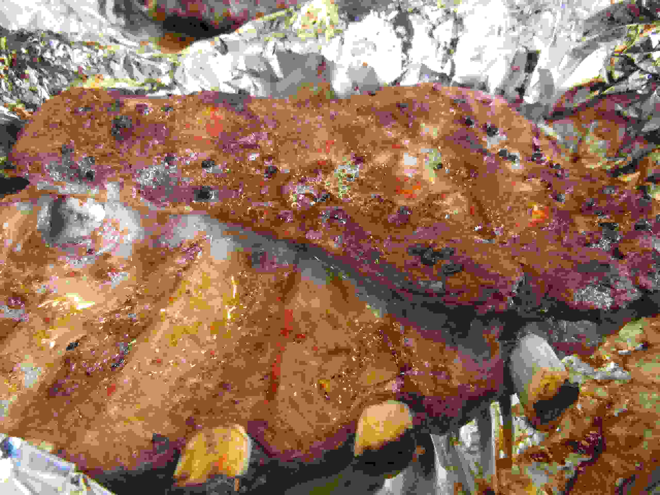 Barbecued spare ribs sizzling on top of foil seasoned with Garlic Capital Lemon Pepper seasoning