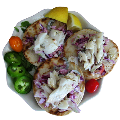 3 grilled street tacos topped with grilled white fish and a spicy cabbage slaw, jalapenos, tomatoes