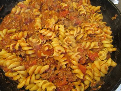Fusilli pasta in a ground beef meat, tomato and chili sauce seasoned with Spicy Garlic No Salt Mix.