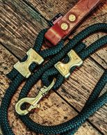 Handcrafted climbing rope leash with top grain leather handle and 100% brass fittings.