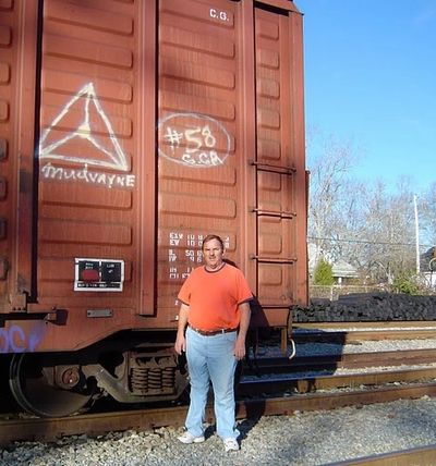 Image of Walter Parks by A boxcar