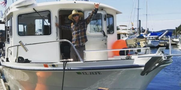 North Shore Charters salmon fishing charters. Captain Sean getting ready to set out on the Jefe