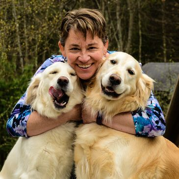 Joanne and her two English cream golden retrievers Violet (left) and Chloe (right)