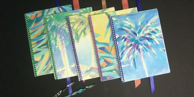 Creative re-purposing of fine art prints into delightful folders, fans, and notebooks.