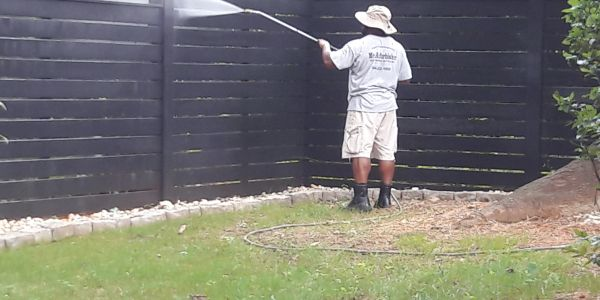Pressure washing a fence