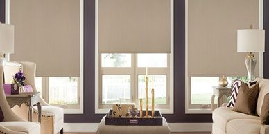 3 blackout roller shades on window with cassette