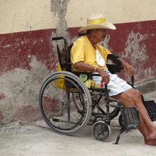 A Mexican  Senior with his own wheelchair.