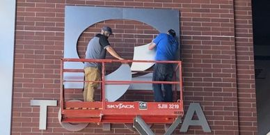 Toyota Club Signage Installation. Scissor Lift. Hammer Drill.