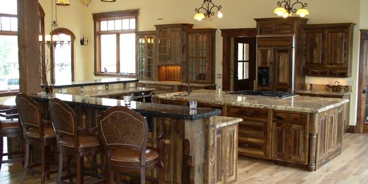 Custom reclaimed oak barnwood kitchen cabinets Lakeside Montana. Old world style with granite tops
