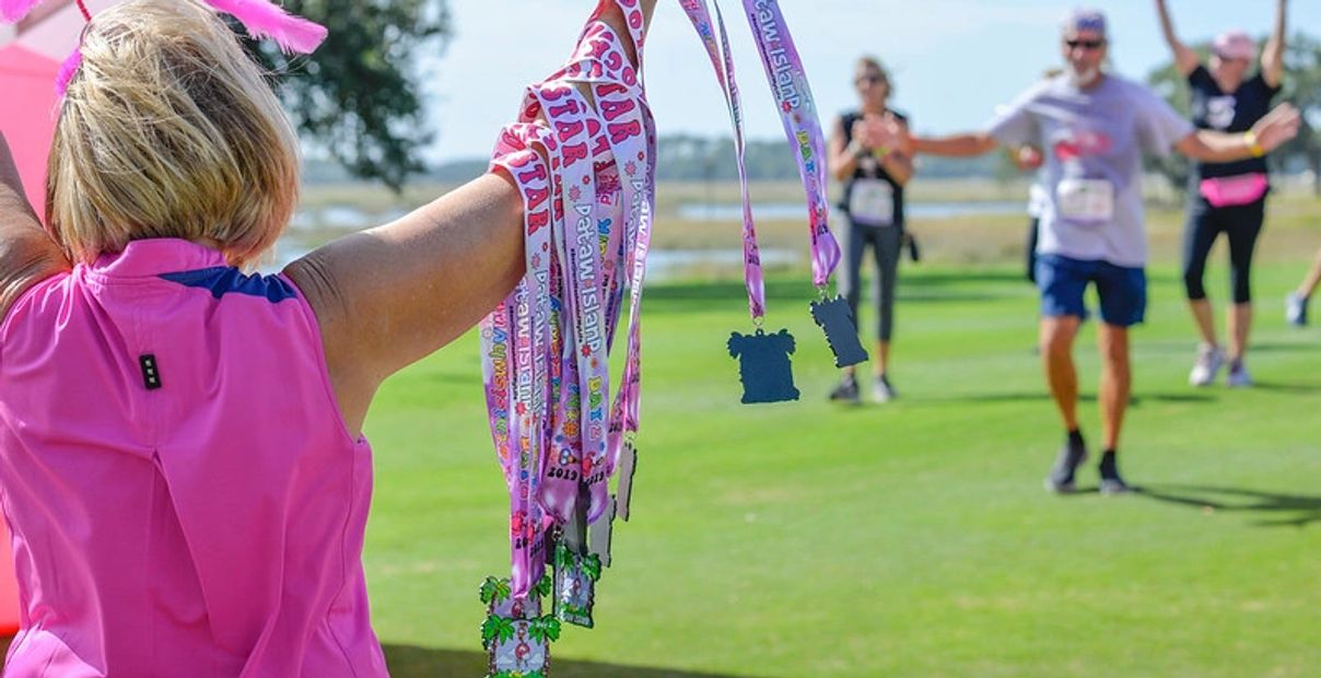 Pledge the Pink Custom Full Color and Glitter Race Medals at finish line of race.