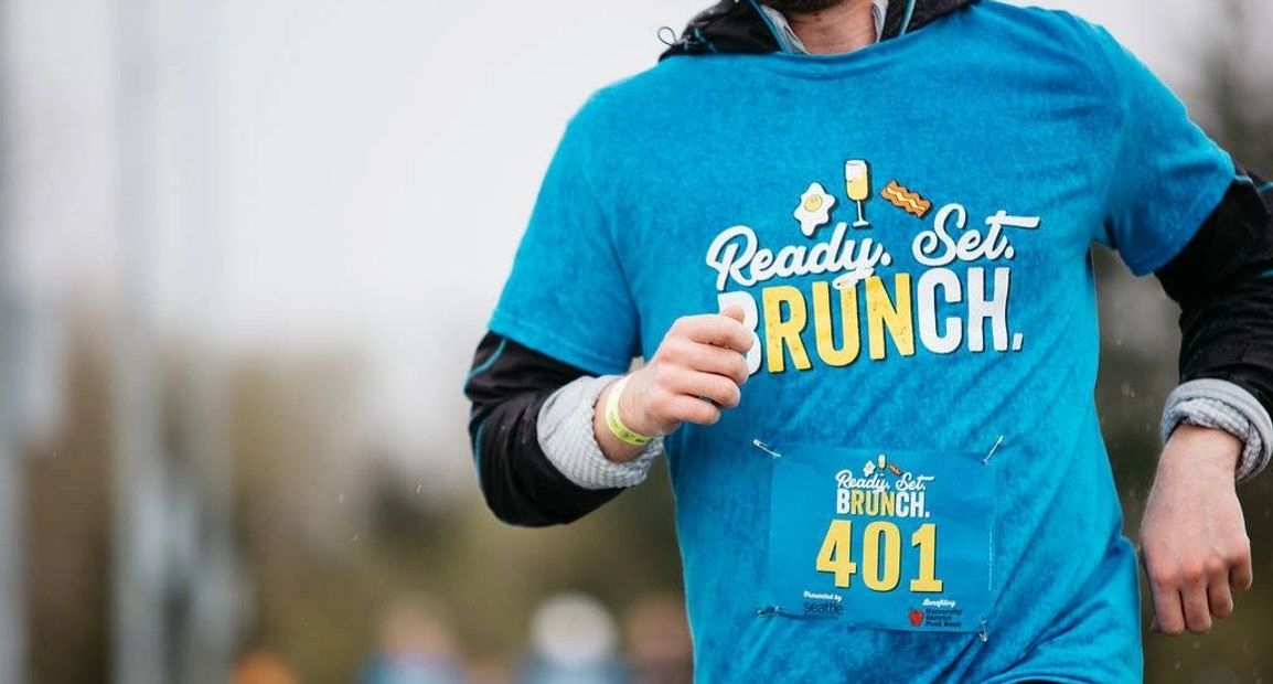 Runner wearing Running Awards and Apparel Cotton Race shirt customized with screen print race brand.