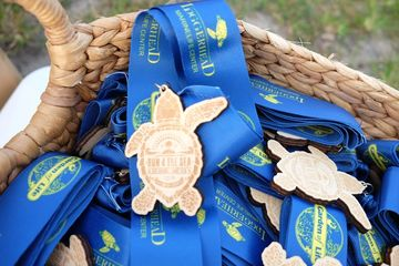 Custom Race Medals made from wood in custom shapes and sizes with colorful ribbons.