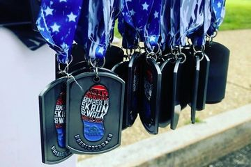 Dog Tag Race Medals customized to showcase running event brands and are popular for military runs.