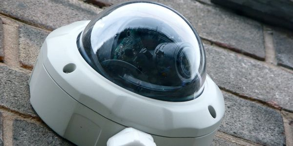 Outdoor dome camera with conduit.