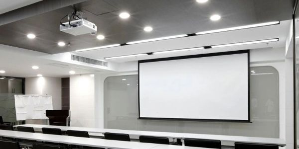 Ceiling mounted projector in a training room.