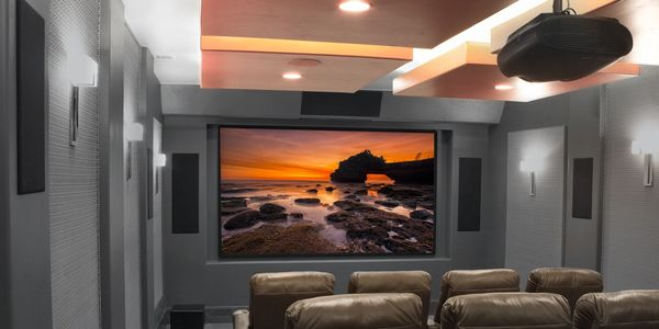 Home theater with ceiling-mounted projector and in-wall TruAudio speakers.