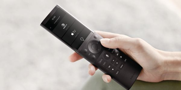 Savant home automation system touch screen universal remote control showing DirecTV, AppleTV, and Lighting options.