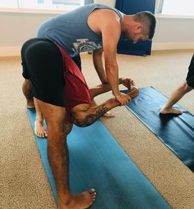 Prasarita padottanasana C Yoga Adjustment