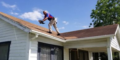 Roof inspected by inspector, man on roof - Allegiance Residential Inspections of Texas