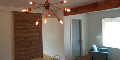 Fixtures, farmhouse door & wood floors in renovated home - Allegiance Residential Inspections of Texas