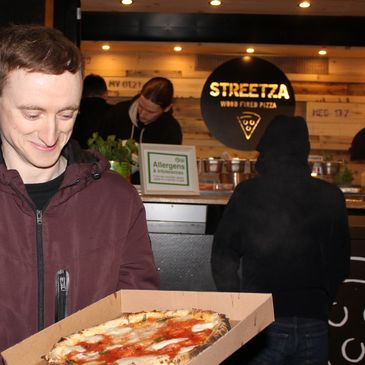 Customer with pizza