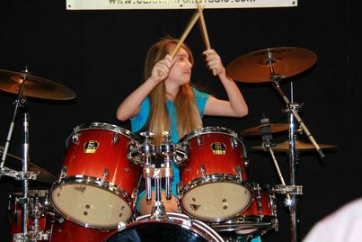 A girl taking drum lessons in Austin, TX