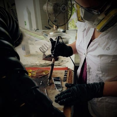 Liza Abelson from Dasken Designs soldering in the stained glass studio