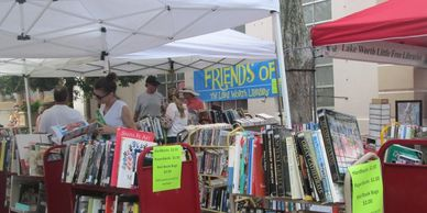 Patrons buying books at the Street Painting Festival book sale