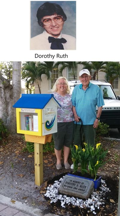 Dorothy's husband Babe, and daughter Cindy at the memorial and Little Free Library that honor her.