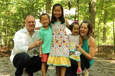 A client family of Agape Adoptions with their three children from China