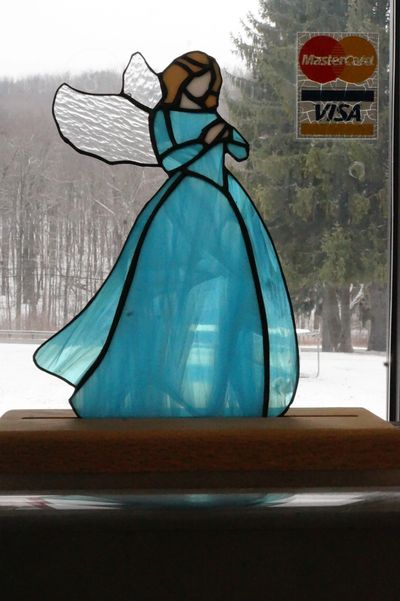 Praying Memorial Angel This beautiful praying angel can be hung in a window or placed on the solid w