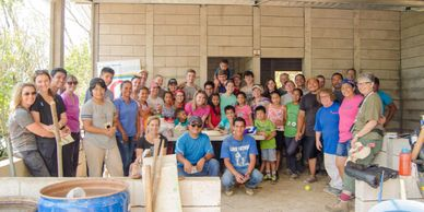 Volunteer group from the US with completed home