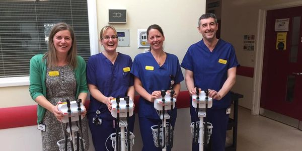 Neonatal charity giving nurse and hospital staff cosytherm unit