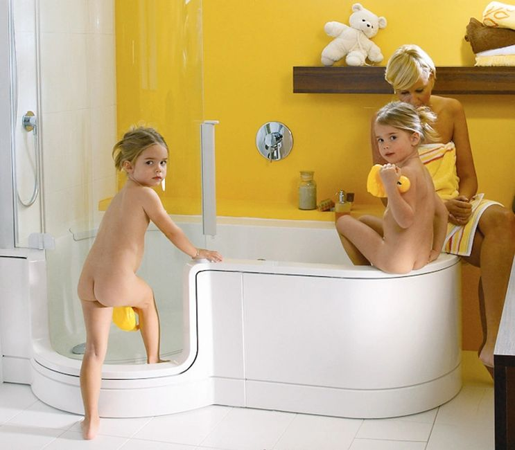 Family photo having a bath using Twinline shower bath