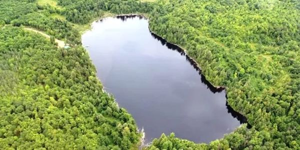 Waterfront property for sale in the Laurentides region, 327 acres with rustic chalet.