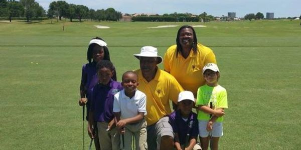 The Foundation youth receive golf lessons from Jim Dent, 12 time PGA Tour Champion
