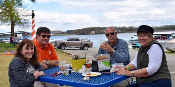 Family and friends enjoying food and drinks at The Grill at Clemson Marina