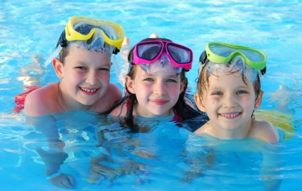 Happy Children in swimming pool in Dallas, Texas due to pool cleaning, pool service and pool repairs