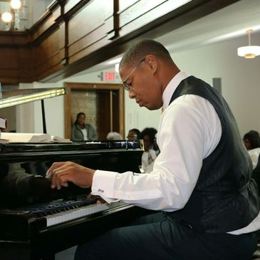 Tedde playing the piano during a service at Capital Hill SDA Church in Washington, DC