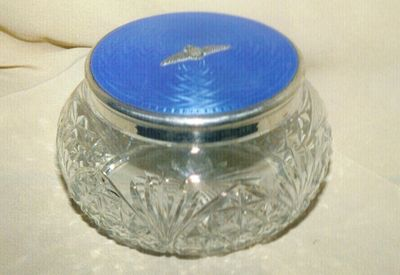 Silver lid fitted with a crystal glass base