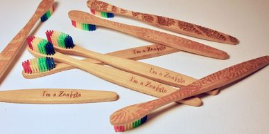 "Bamboo toothbrushes with coral engraving on back and ""I'm a Zoaista"" on the handle"