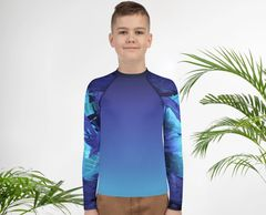"boy wearing ""a purple urchin sunset"" youth rash guard by Living Sea Sculpture and Colleen Flanigan"