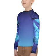Side view wearing youth boy's rash guard by Living Sea Sculpture coral reef restoration designs