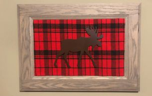 "Moose Plaid wall hanging is 23"" wide and  16"" tall."