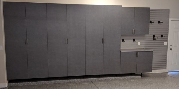 Pewter Garage Cabinets with a stainless steel countertop