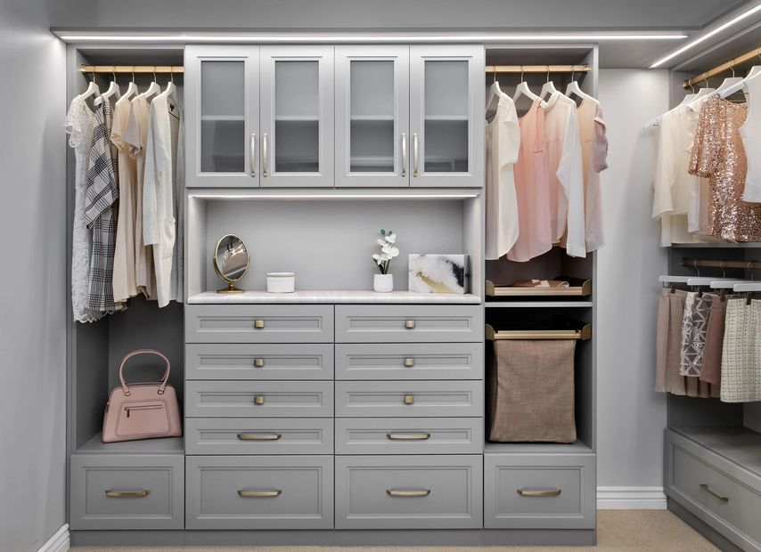 Walk-In closet in the New Super Matte Cloud Finish with Matte Gold Hardware and Strip Lighting