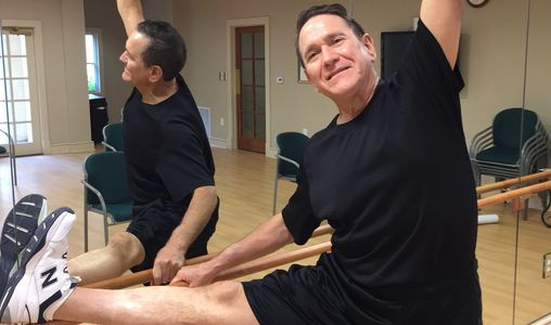Charles with leg on a ballet barre